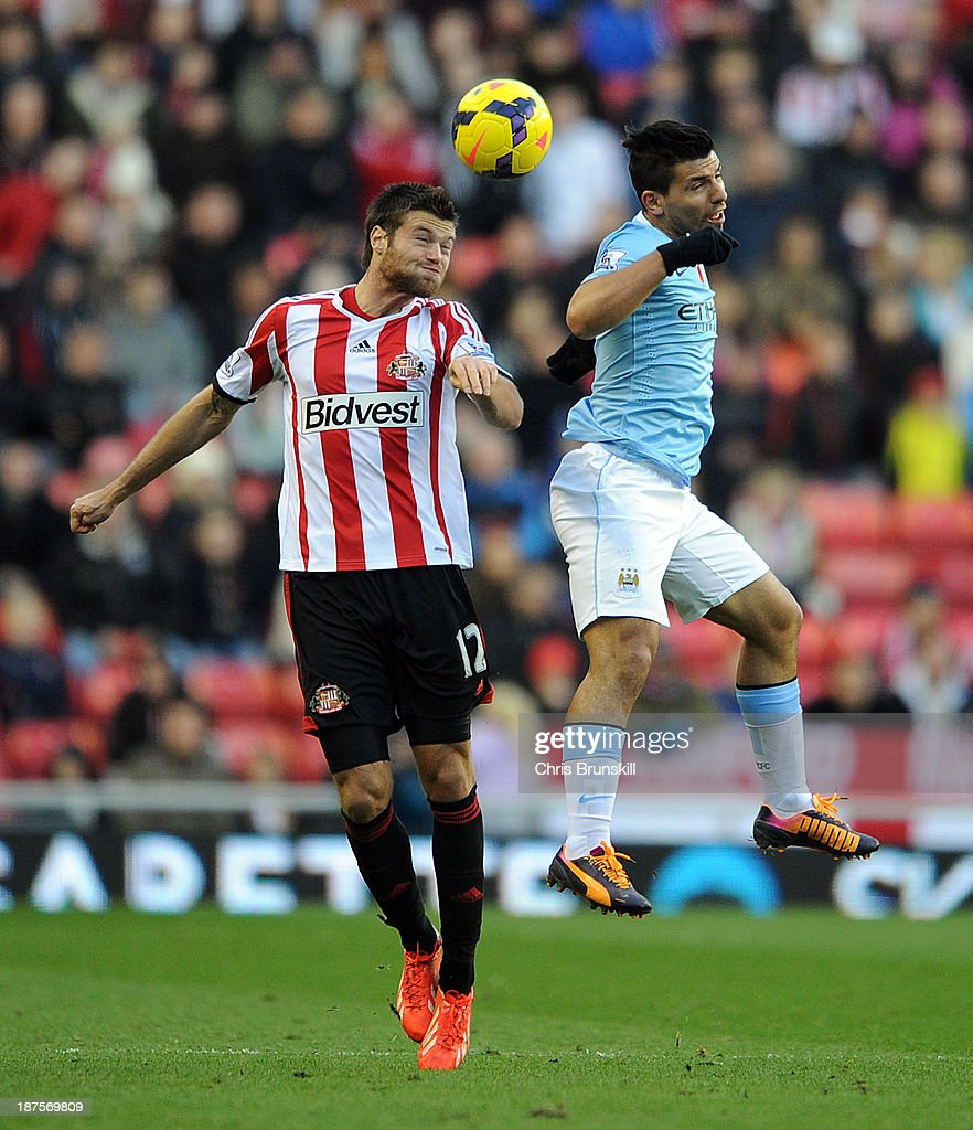 Ondrej Celustka of Sunderland in action with Sergio Aguero of Manchester City during the Barclays Premier League match between Sunderland and Manchester City at Stadium of Light on November 10, 2013 in Sunderland, England.