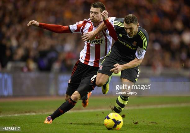 Ondrej Celustka of Sunderland is tackled by Erik Pieters of Stoke City during the Premier League match between Sunderland and Stoke City at Stadium...