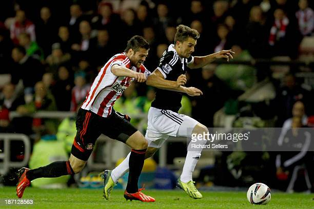 Ondrej Celustka of Sunderland vies with Jay Rodriguez of Southampton during the Capital One Cup fourth Round match between Sunderland and Southampton...