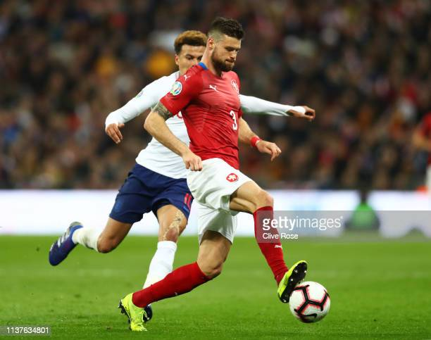 Ondrej Celustka of the Czech Republic evades Dele Alli of England during the 2020 UEFA European Championships Group A qualifying match between...