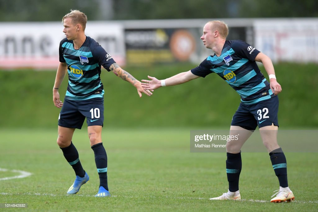 Ondrej Duda and Dennis Jastrzembski of Hertha BSC klatschen ab during the test test match between Hertha BSC and Aiginiakos FC at the Athletic Area Schladming on august 10, 2018 in Schladming, Austria.