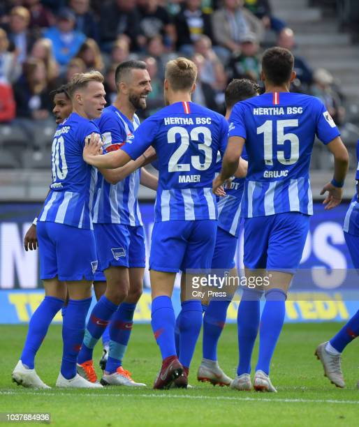 Ondrej Duda Arne Maier and Marko Grujic of Hertha BSC celebrate after scoring the 11 during the game between Hertha BSC and Borussia Moenchengladbach...