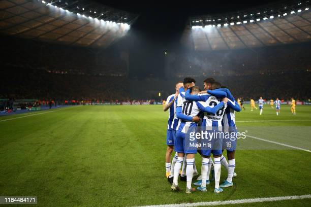 Ondrej Duda celebrates with teammates after scoring his sides second goal during the DFB Cup second round match between Hertha BSC and Dynamo Dresden...