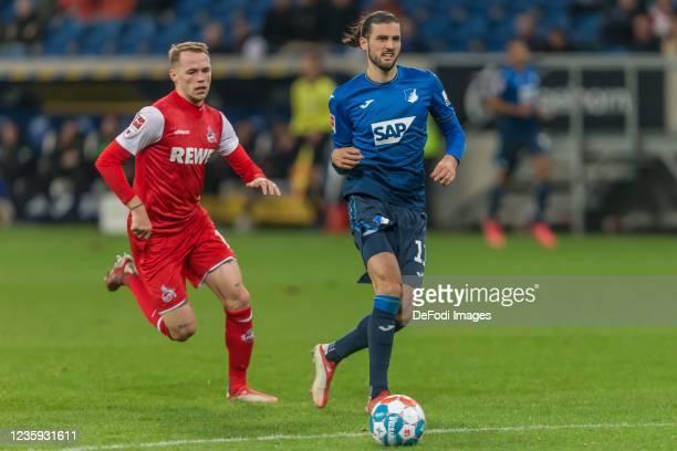 Ondrej Duda of 1.FC Koeln and Florian Grillitsch of TSG 1899 Hoffenheim battle for the ball during the Bundesliga match between TSG Hoffenheim and 1....