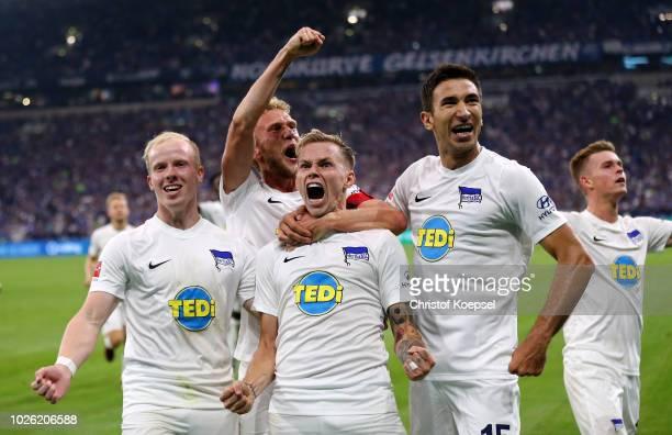 Ondrej Duda of Berlin celebrates the second goal with Dennis Jastrzembski Fabian Lustenberger and Marko Grujic of Berlin during the Bundesliga match...