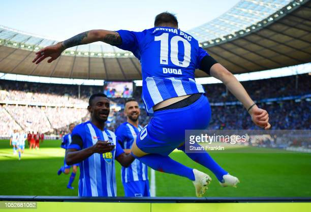 Ondrej Duda of Hertha BSC jumps the hoardings as he celebrates scoring his team's first goal with team mate Salomon Kalou during the Bundesliga match...