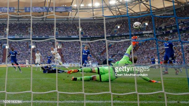 Ondrej Duda of Hertha BSC scores his team's first goal past Ralf Fährmann of FC Schalke 04 during the Bundesliga match between FC Schalke 04 and...
