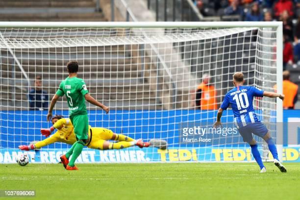 Ondrej Duda of Hertha BSC scores his team's fourth goal past Yann Sommer of Borussia Monchengladbach during the Bundesliga match between Hertha BSC...