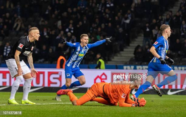 Ondrej Duda of Hertha celebrates with team mates after scoring his team's second goal against goalkeeper Andreas Luthe of FC Augsburg BSC during the...