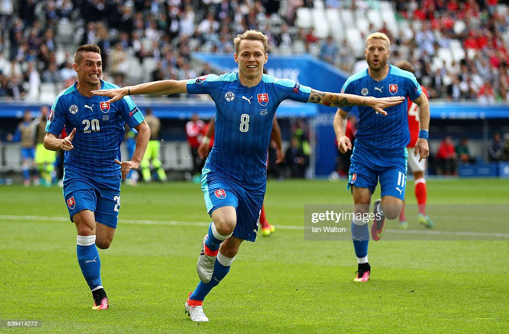 Ondrej Duda of Slovakia celebrates scoring his team's first goal during the UEFA EURO 2016 Group B match between Wales and Slovakia at Stade Matmut Atlantique on June 11, 2016 in Bordeaux, France.