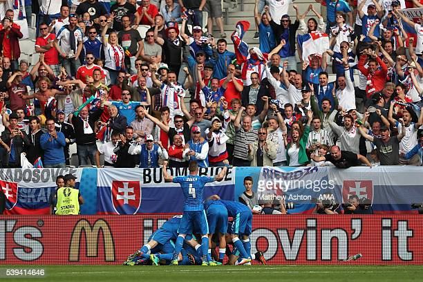Ondrej Duda of Slovakia celebrates with his teammates after scoring a goal to make the score 11 during the UEFA EURO 2016 Group B match between Wales...