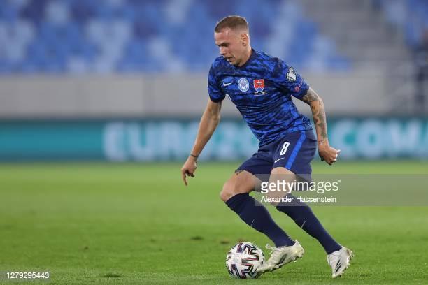 Ondrej Duda of Slovakia runs with the ball during the UEFA EURO 2020 Play-Off Semi-Final match between Slovakia and Republic of Ireland at Tehelne...