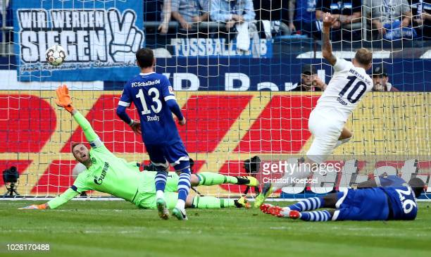 Ondrej Duda scores the first goal against Ralf Faehrmann of Schalke of Berlin during the Bundesliga match between FC Schalke 04 and Hertha BSC at...
