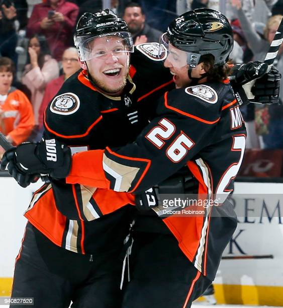 Ondrej Kase and Brandon Montour of the Anaheim Ducks celebrate Kase's overtime goal as the Ducks defeat the Colorado Avalanche 43 in the game at...