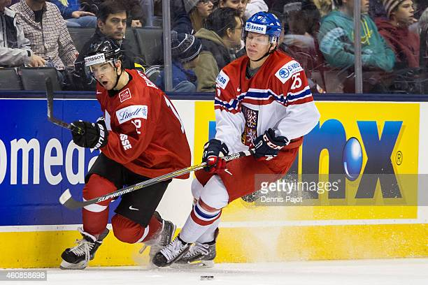 Ondrej Kase of Czech Republic moves the puck against Jason Fuchs of Switzerland during the 2015 IIHF World Junior Championship on December 27 2014 at...