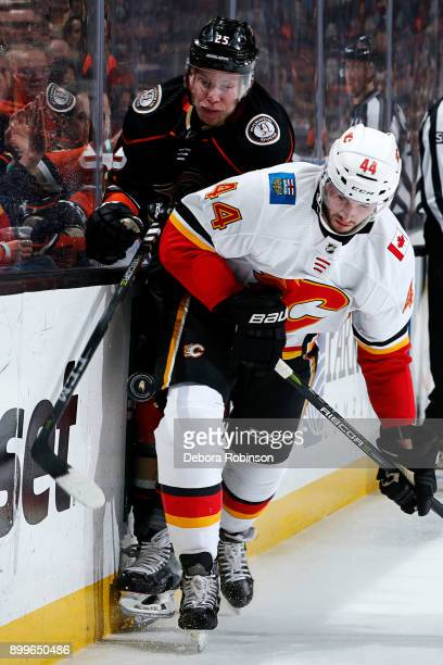 Ondrej Kase of the Anaheim Ducks battles for the puck against Matt Bartkowski of the Calgary Flames during the game on December 29, 2017 at Honda...