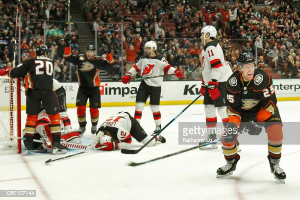 Ondrej Kase of the Anaheim Ducks celebrates a goal as Ben Lovejoy of the New Jersey Devils despairs at Honda Center on December 09 2018 in Anaheim...