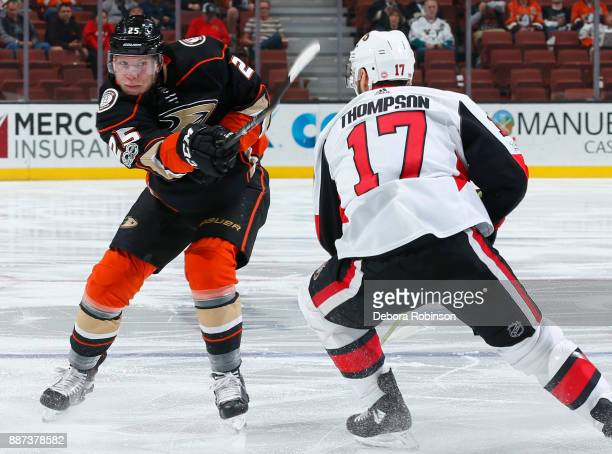 Ondrej Kase of the Anaheim Ducks dumps the puck with pressure from Nate Thompson of the Ottawa Senators during the game on December 6 2017 at Honda...