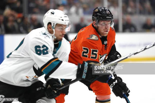 Ondrej Kase of the Anaheim Ducks eludes Kevin Labanc of the San Jose Sharks during the third period of a game at Honda Center on October 05 2019 in...