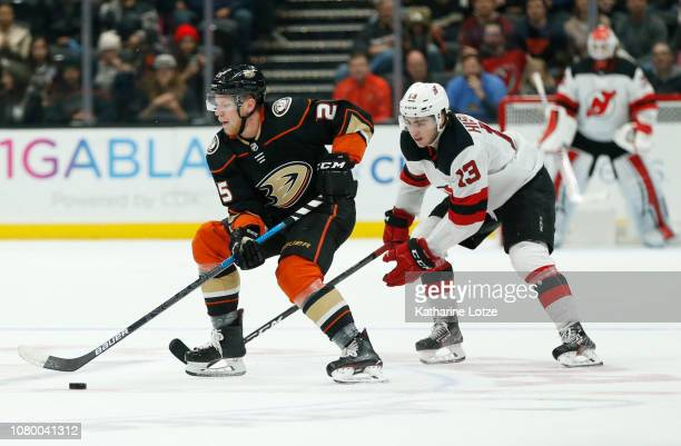 Ondrej Kase of the Anaheim Ducks keeps the puck from Nico Hischier of the New Jersey Devils at Honda Center on December 09 2018 in Anaheim California