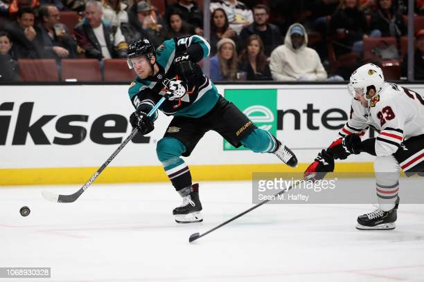 Ondrej Kase of the Anaheim Ducks shoots the puck and scores past the defense of Brandon Manning of the Chicago Blackhawks during the third period of...