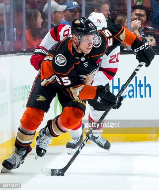 Ondrej Kase of the Anaheim Ducks skates with the puck with pressure from Blake Coleman of the New Jersey Devils during the first period of the game...