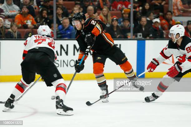 Ondrej Kase of the Anaheim Ducks takes a shot on goal as Egor Yakovlev of the New Jersey Devils tries to block at Honda Center on December 09 2018 in...
