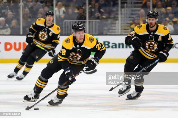 Ondrej Kase of the Boston Bruins skates down ice against the Dallas Stars in his first game as a Bruin during the first period at TD Garden on...