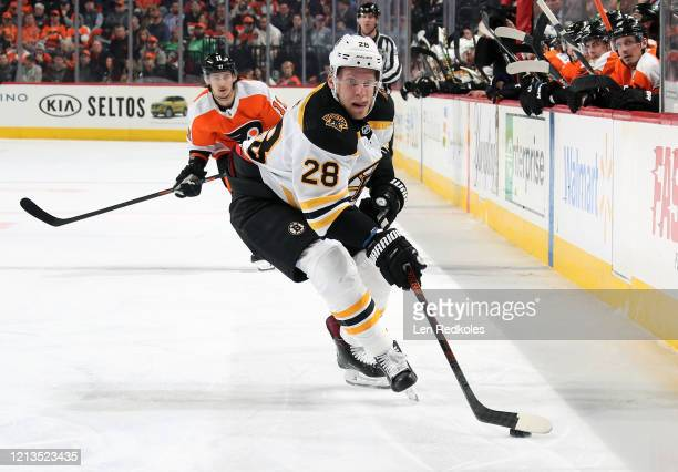 Ondrej Kase of the Boston Bruins skates the puck against Travis Konecny of the Philadelphia Flyers on March 10 2020 at the Wells Fargo Center in...