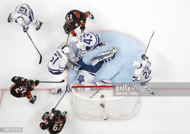 Ondrej Kase, Ryan Getzlaf and Rickard Rakell of the Anaheim Ducks poke at a loose puck as Garret Sparks, Jake Gardiner, Nikita Zaitsev and Patrick...
