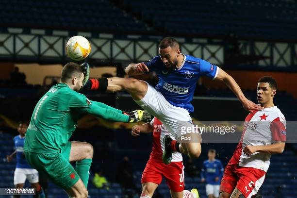 Ondrej Kolar of Slavia Praha is challenged by Kemar Roofe of Rangers which leads to a red card being shown during the UEFA Europa League Round of 16...