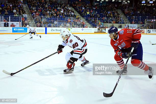 Ondrej Machala of the Niagara IceDogs skates with the puck as Domenic Commisso of the Oshawa Generals chases during the second period of an OHL game...