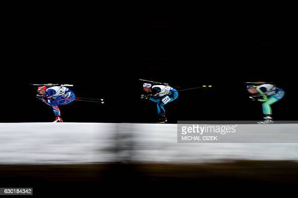 TOPSHOT Ondrej Moravec of Czech Republic Quentin Fillon Maillet of France and Dmytro Pidruchnyi of Ukraine compete during Men 15 Km mass start...