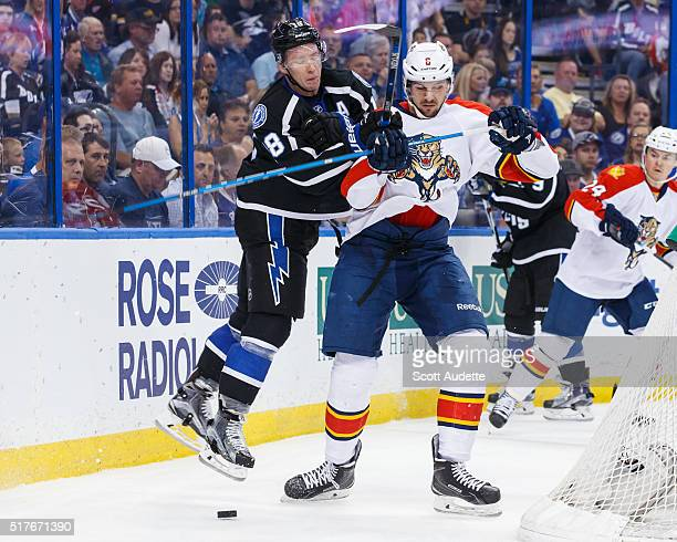 Ondrej Palat of the Tampa Bay Lightning battles against Alex Petrovic of the Florida Panthers during the first period at the Amalie Arena on March 26...