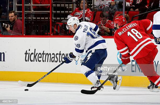 Ondrej Palat of the Tampa Bay Lightning carries the puck ahead of Jay McClement of the Carolina Hurricanes during a NHL game at PNC Arena on November...
