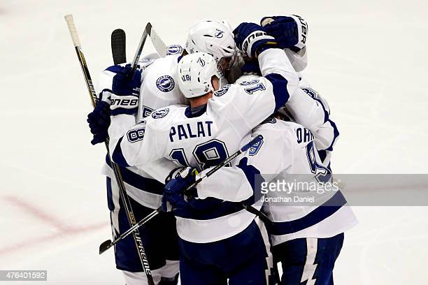 Ondrej Palat of the Tampa Bay Lightning celebrates a third period goal with teammates against the Chicago Blackhawks during Game Three of the 2015...