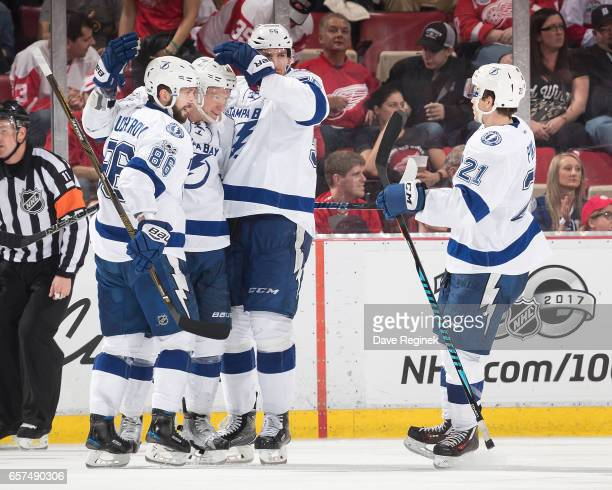 Ondrej Palat of the Tampa Bay Lightning celebrates his third period goal with teammates Nikita Kucherov Braydon Coburn and Brayden Point during an...