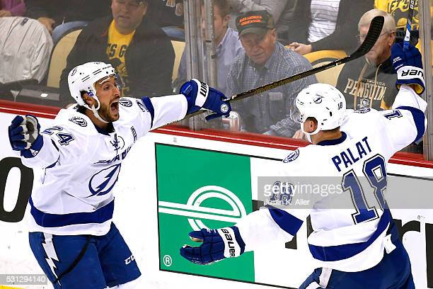 Ondrej Palat of the Tampa Bay Lightning celebrates with his teammate Ryan Callahan after scoring a goal in the second period against Matt Murray of...