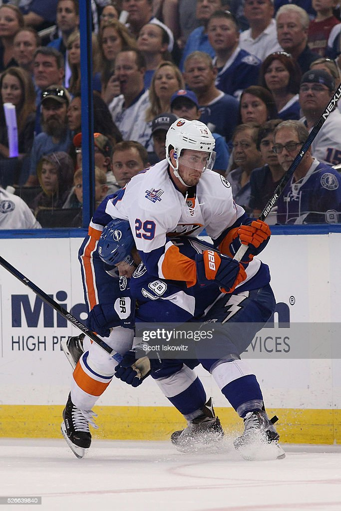 Ondrej Palat #18 of the Tampa Bay Lightning collides with Brock Nelson #29 of the New York Islanders during the first period in Game Two of the Eastern Conference Second Round during the 2016 NHL Stanley Cup Playoffs at Amalie Arena on April 30, 2016 in Tampa, Florida.