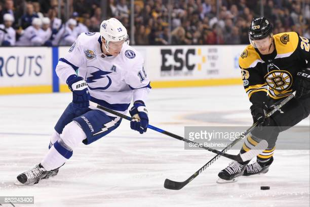 Ondrej Palat of the Tampa Bay Lightning fights for the puck against Riley Nash of the Boston Bruins at the TD Garden on November 29 2017 in Boston...