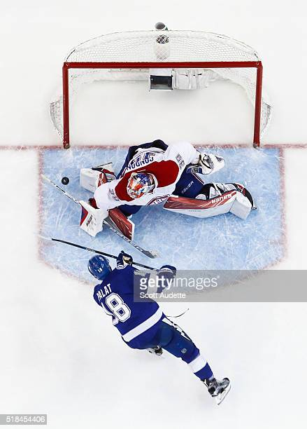 Ondrej Palat of the Tampa Bay Lightning has his shot saved by goalie Mike Condon of the Montreal Canadiens during the second period at the Amalie...