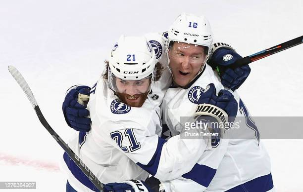 Ondrej Palat of the Tampa Bay Lightning is congratulated by Brayden Point after scoring a goal against the Dallas Stars during the second period in...