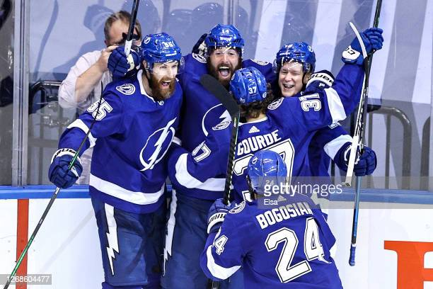 Ondrej Palat of the Tampa Bay Lightning is congratulated by his teammates after scoring a goal in overtime to win Game Two of the Eastern Conference...