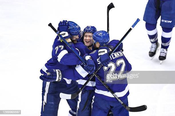 Ondrej Palat of the Tampa Bay Lightning is congratulated by his teammates after scoring a goal against the Boston Bruins during the second period in...
