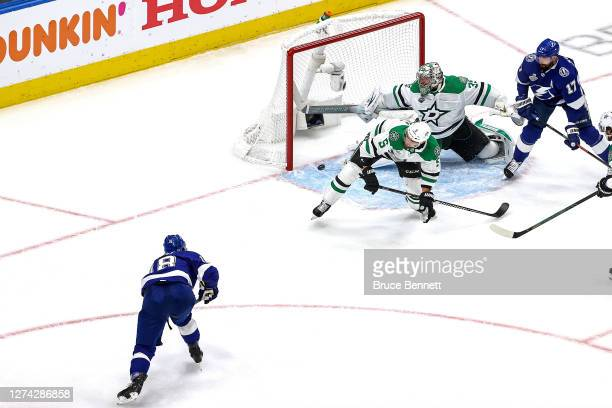 Ondrej Palat of the Tampa Bay Lightning scores a goal past Anton Khudobin of the Dallas Stars during the first period in Game Two of the 2020 NHL...