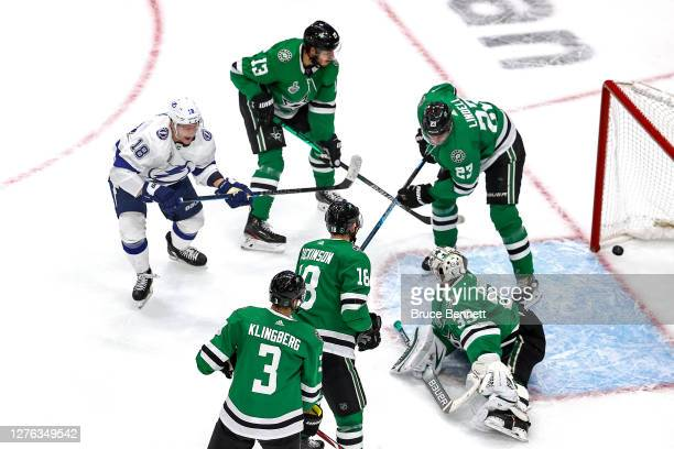 Ondrej Palat of the Tampa Bay Lightning scores a goal past Anton Khudobin of the Dallas Stars during the second period in Game Three of the 2020 NHL...