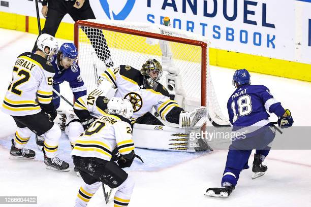 Ondrej Palat of the Tampa Bay Lightning scores a goal past Jaroslav Halak of the Boston Bruins during overtime to win Game Two of the Eastern...