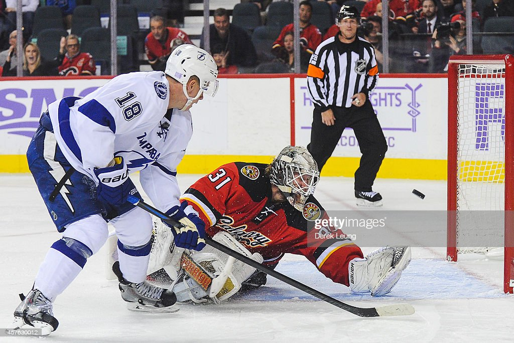 Ondrej Palat #18 of the Tampa Bay Lightning scores the overtime game winning goal against Karri Ramo #31 of the Calgary Flames during an NHL game at Scotiabank Saddledome on October 21, 2014 in Calgary, Alberta, Canada.