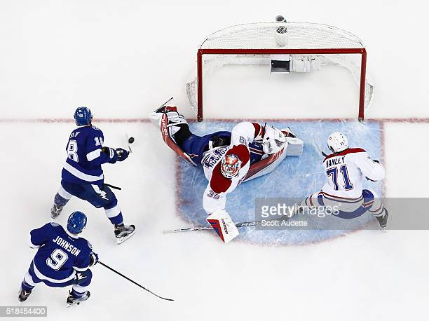 Ondrej Palat of the Tampa Bay Lightning shoots the puck against goalie Mike Condon of the Montreal Canadiens during the second period at the Amalie...