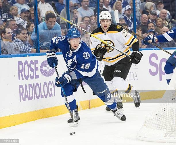 Ondrej Palat of the Tampa Bay Lightning skates against Brandon Carlo of the Boston Bruins during the first period at Amalie Arena on November 3 2016...